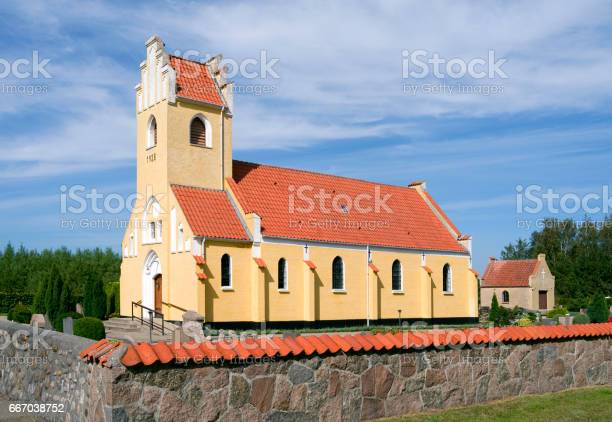 Denmark: The church in Oesterby gleams in the afternoon sun
