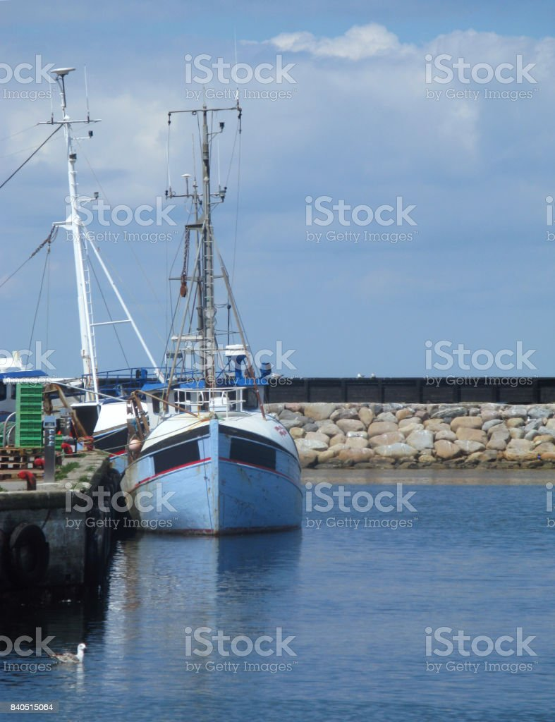 Denmark: Wooden fishing cutters moored at a quayside in a fishing port in North Jutland stock photo