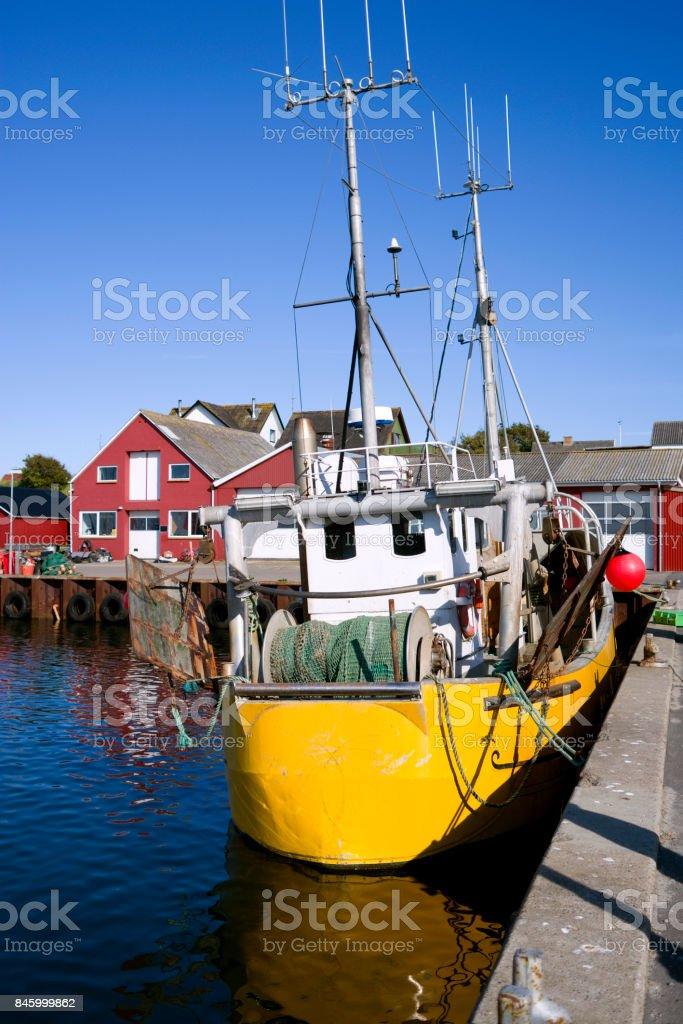 Denmark: Yellow fishing boat in a small fishing port in North Jutland stock photo