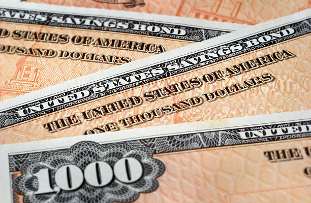 $1000 denomination us savings bonds - stock certificate stock photos and pictures