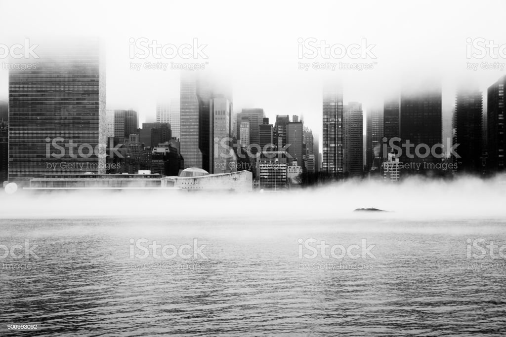 A dense fog covered New York City during the winter's day on January of 2018. View of Manhattan and United Nations building. stock photo