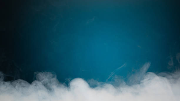 dense smoke on blue background dense smoke on blue background with copy-space electronic cigarette stock pictures, royalty-free photos & images