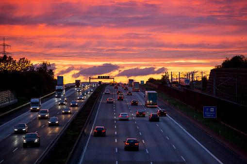Dense traffic and road users on German highway A3 near Wiesbadener Kreuz at dusk.