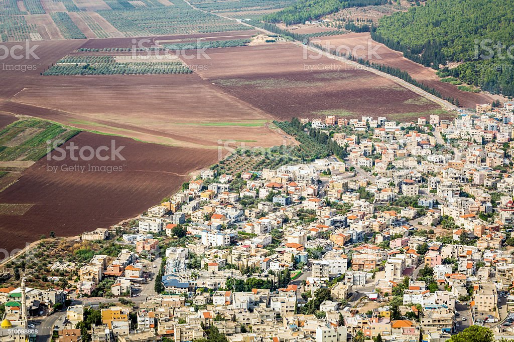 Densely populated city and fertile fields, Israel stock photo
