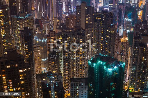 Aerial view across the crowded highrise cityscape of closely packed apartment buildings on Hong Kong Island, China.