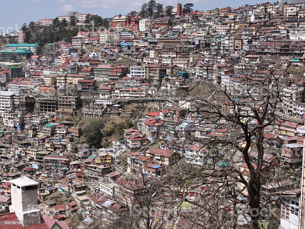 Densely populated hillside in the town of Shimla, India stock photo