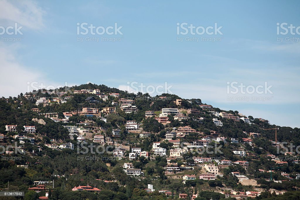 densely populated mountain stock photo