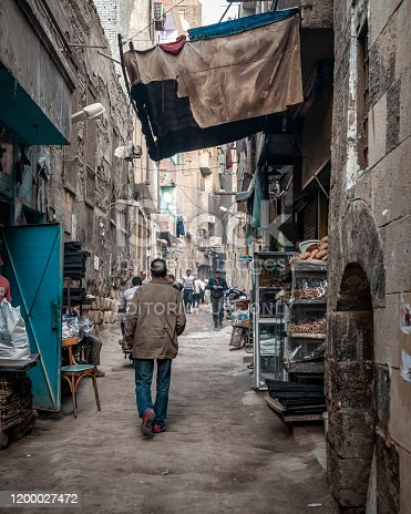 Egyptians walk in an alley in a densely populated neighborhood in the Islamic Cairo area of Cairo, Egypt. (March 23, 2010)