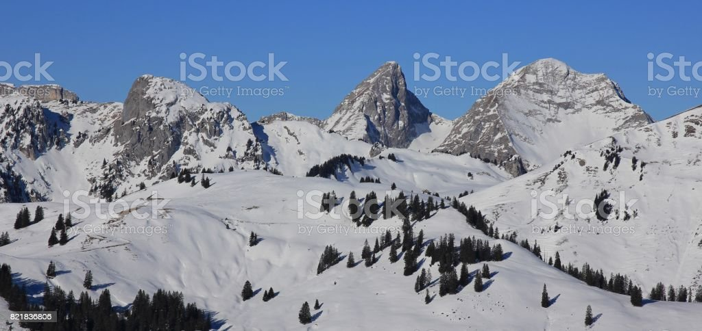 Dent de Ruth and other snow covered mountains seen from mount Rellerli, Switzerland. stock photo