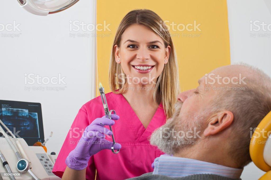 Dental anesthesia injection stock photo