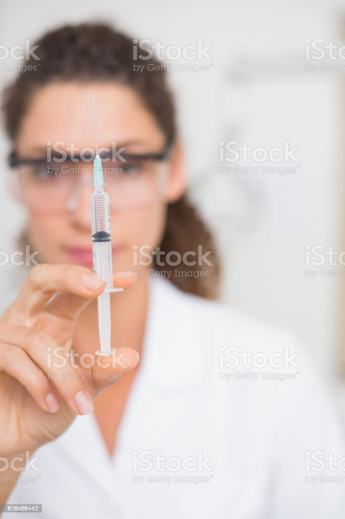 Dental assistant preparing an injection stock photo