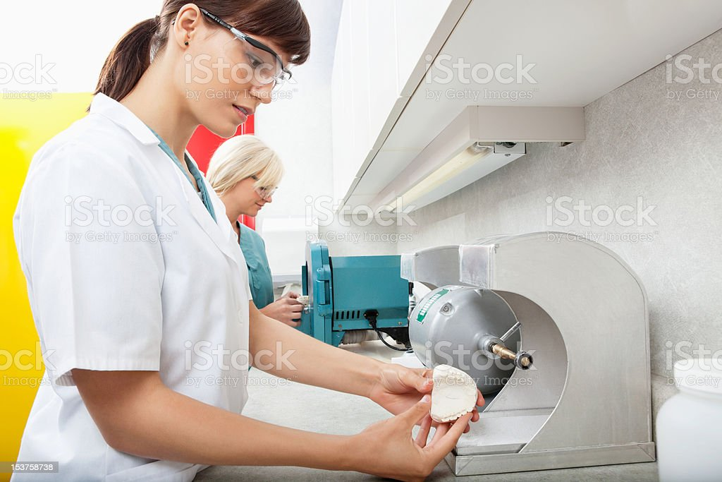 Dental Assistant with Tooth Impression stock photo