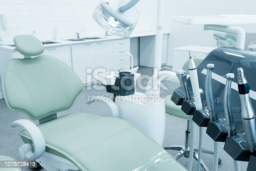 Dental chair and equipment. Patient reception room in a modern medical center. Toned