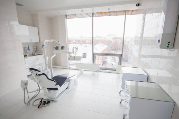 dental clinic interior with modern dentistry equipment - dentists office stock pictures, royalty-free photos & images
