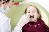 Dental exam with cute little girl
