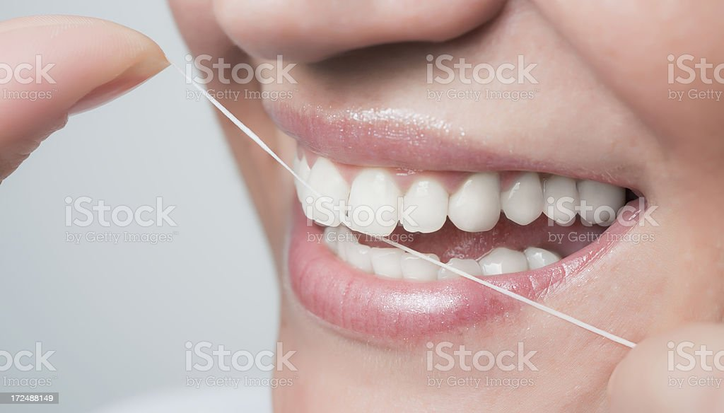 Dental floss for beautiful smile stock photo