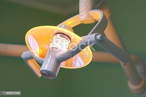 istock Dental handle lamp 1133552055