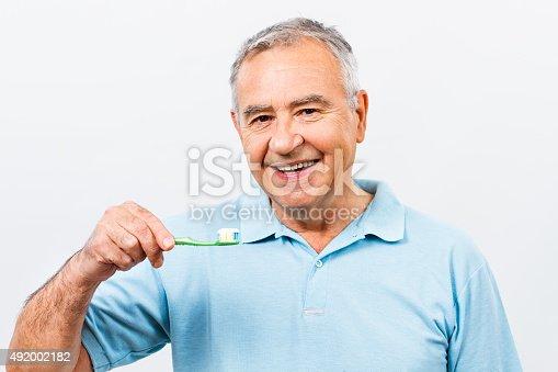 istock Dental hygiene for senior man 492002182