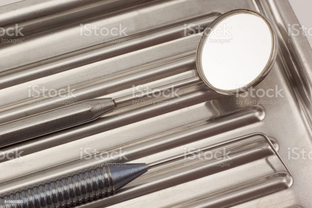 Dental instruments are lying in a medical tray. stock photo