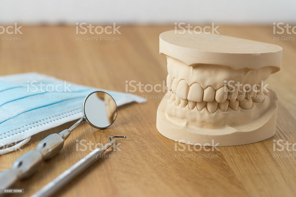 Dental mold with tools and a face mask stock photo