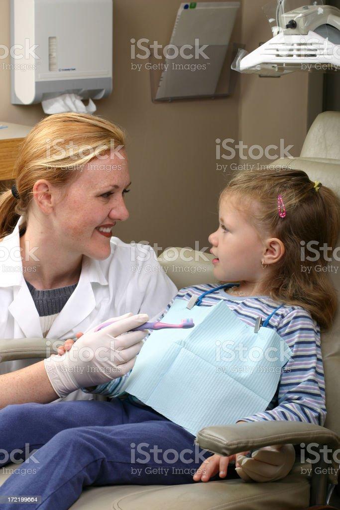 Dental Office Visit - Brushing royalty-free stock photo