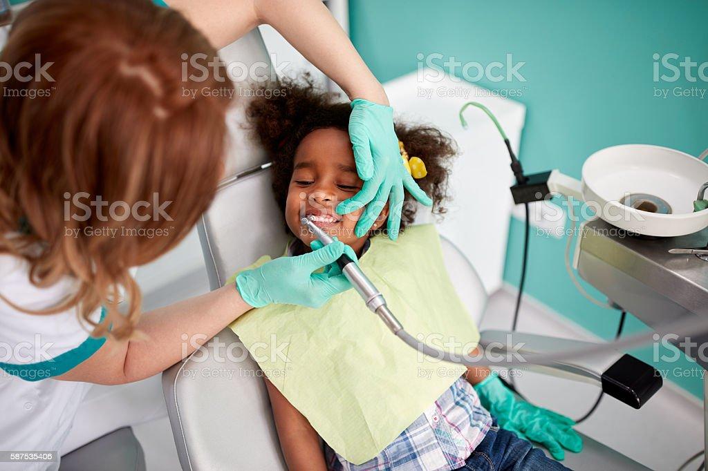 Dental polishing treatment in dental clinic stock photo