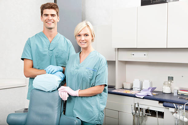 dental team - dental assistant stock photos and pictures