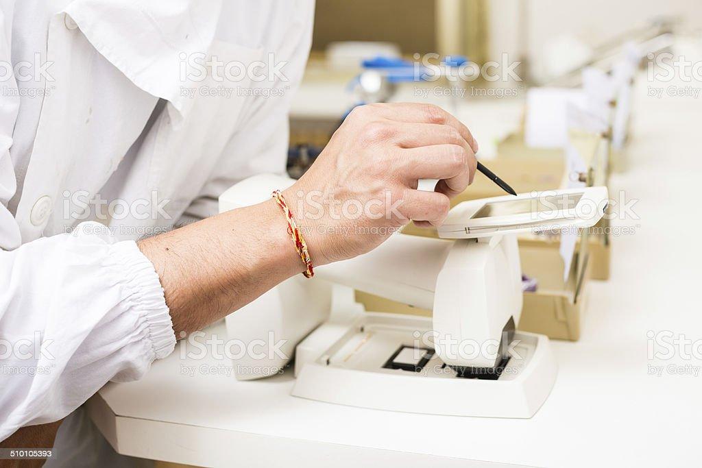 Dental technician at work stock photo
