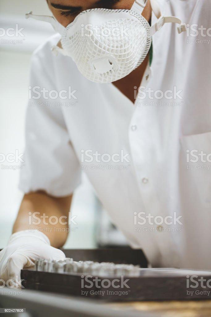 Dental technician checking dentures stock photo