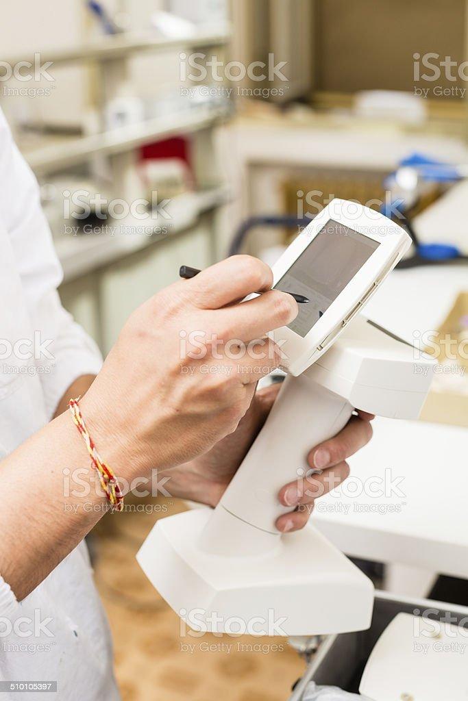 Dental Technician Using Touch Screen stock photo