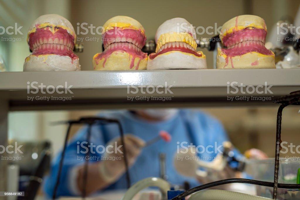 Dental technician working on dental prosthetic stock photo