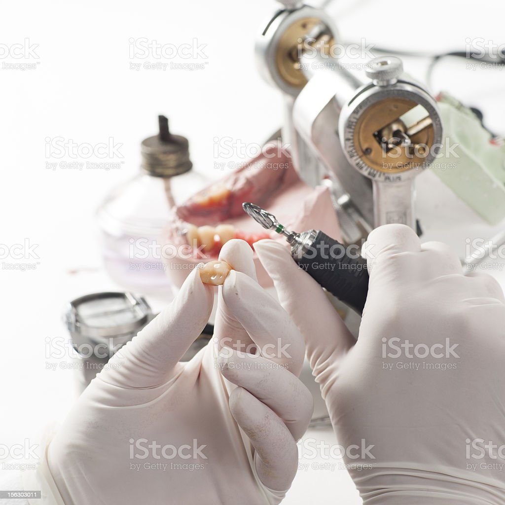 Dental technician working with articulator royalty-free stock photo