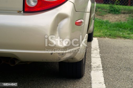 Car with dented bumper.