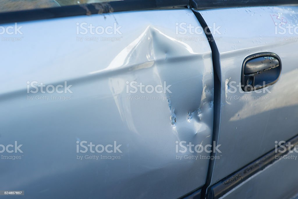 Dented Car Door stock photo