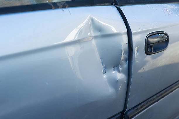 dented car door - dent stock pictures, royalty-free photos & images