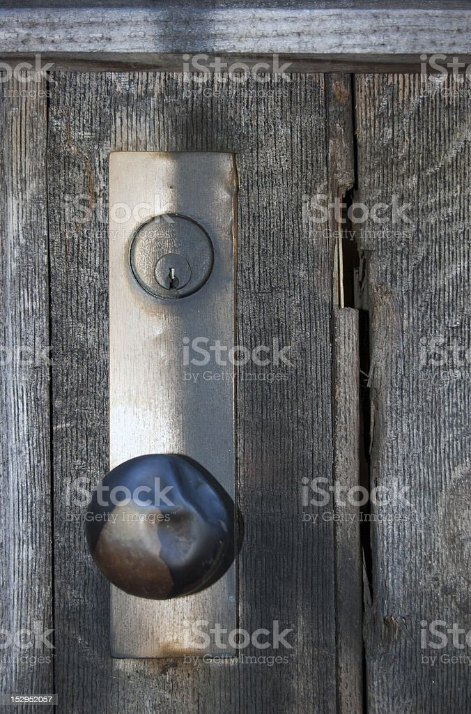 Dented old doorknob on wood stock photo