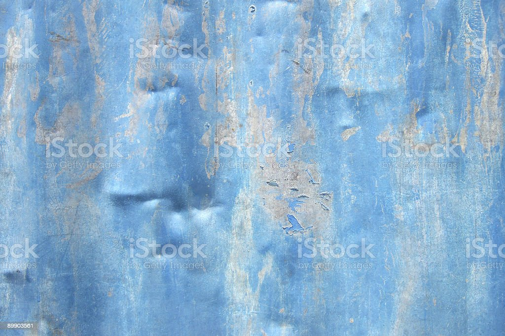 Dented tin sheet with peeling blue paint royalty-free stock photo