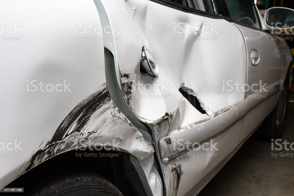 Dented up car from a wreck royalty-free stock photo