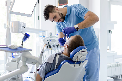 Dentis Giving Anesthesia To Patient Stock Photo - Download Image Now