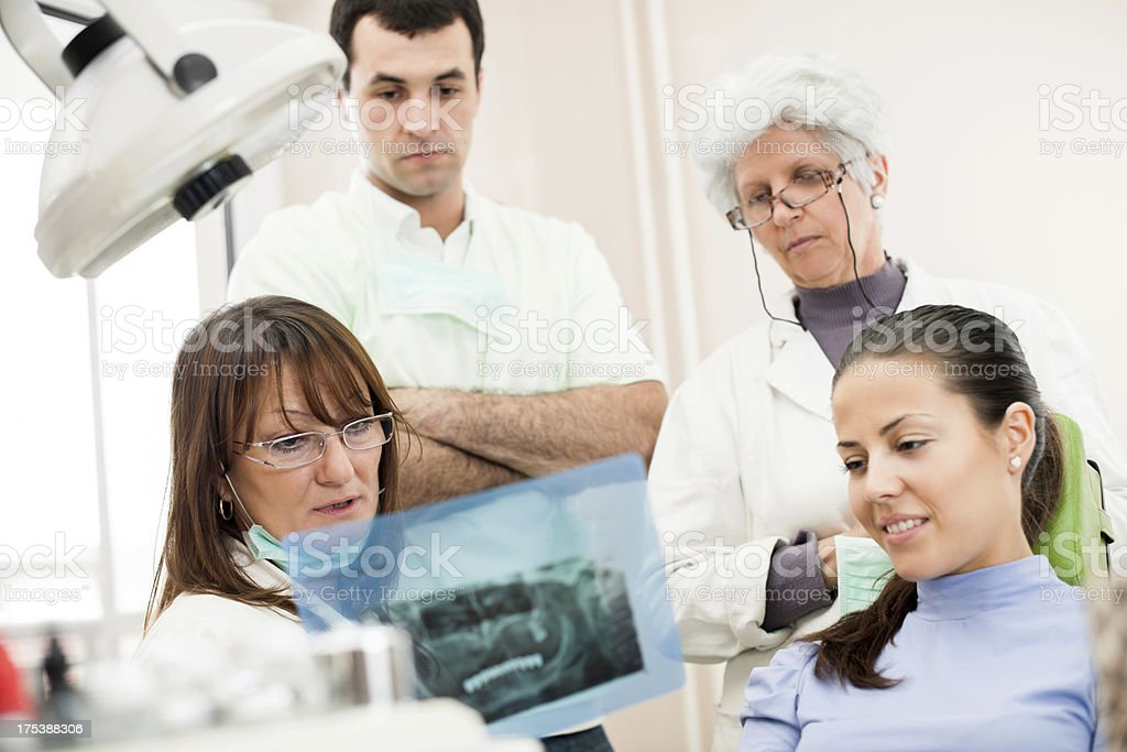 Dentist and patient looking at tooth x-ray. royalty-free stock photo