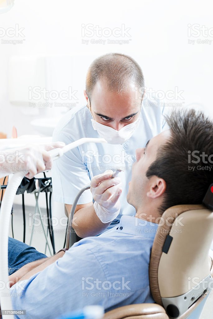 Dentist and patient royalty-free stock photo