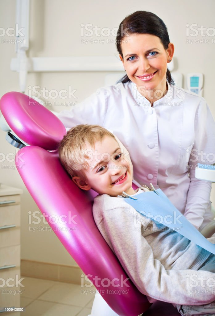 Dentist and Young Boy Patient Smiling royalty-free stock photo
