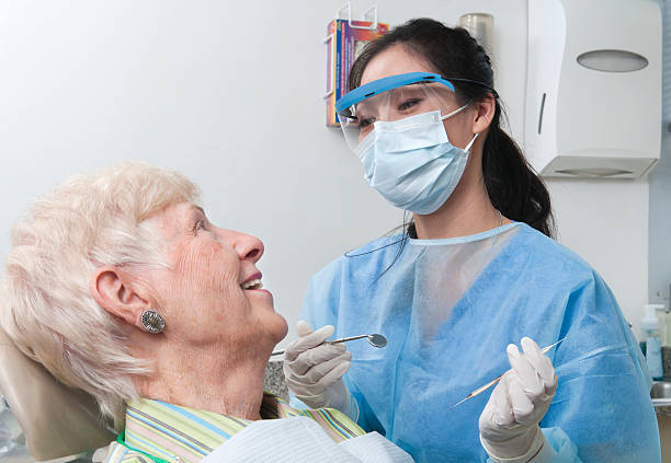 Dentist Appointment - Hygienist and Senior Patient stock photo
