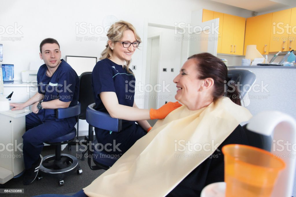 Dentist check and repair tooth of senior woman royalty-free stock photo