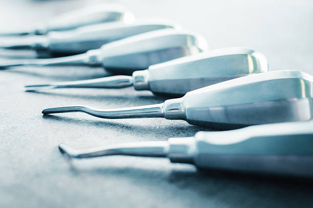 Dentist chisels tools arranged on table by size stock photo