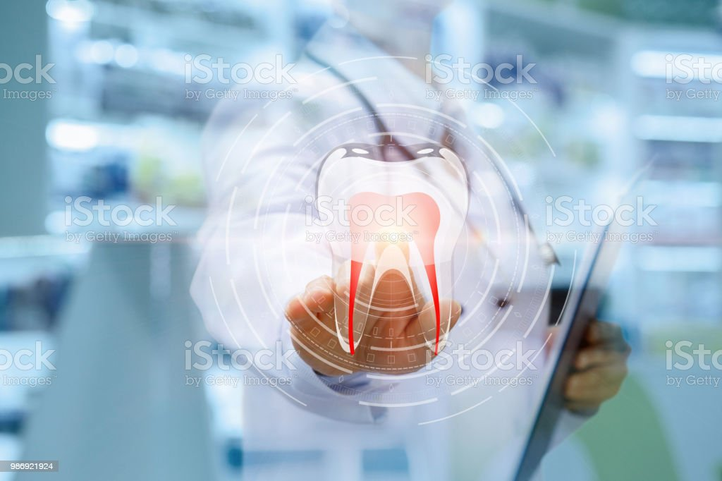 Dentist Clicks On The Icon Of A Tooth Stock Photo Download Image