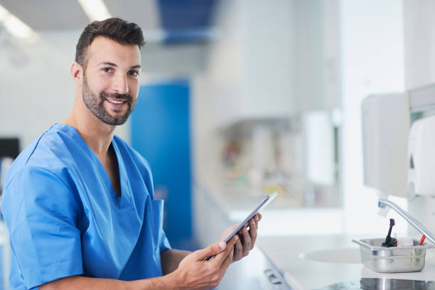 dentist doctor and medical concepts in barcelona - dental assistant stock photos and pictures
