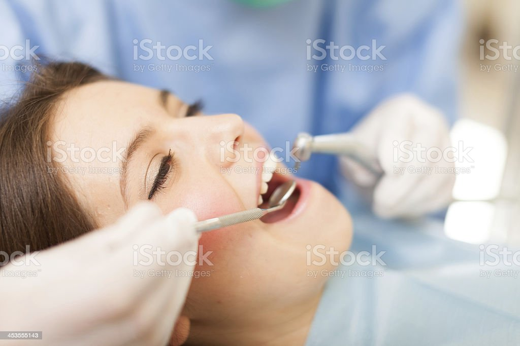 Dentist doing a treatment stock photo