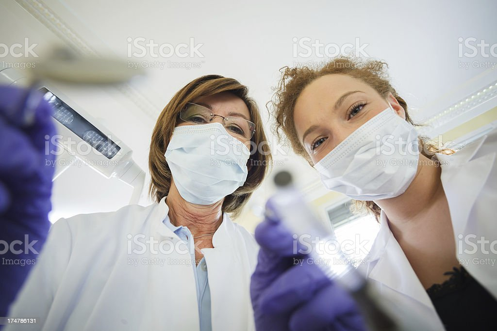 Dentist examining Patient stock photo