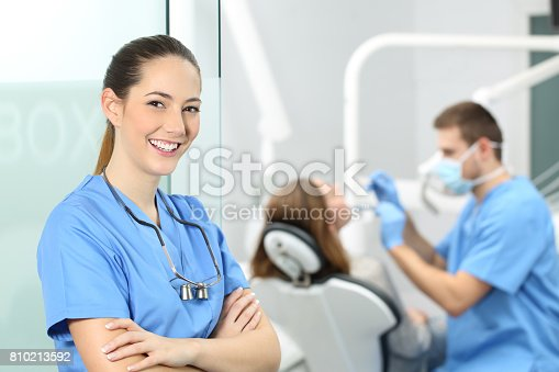 istock Dentist female posing at consultation 810213592